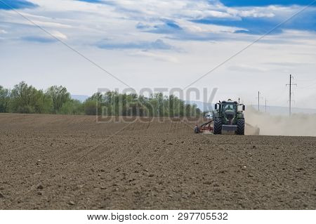 Farmer Seeding, Sowing Crops At Field. Sowing Is The Process Of Planting Seeds In The Ground As Part