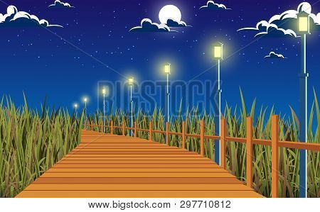 Landscape Of Wooden Walkway At The Meadow In The Night