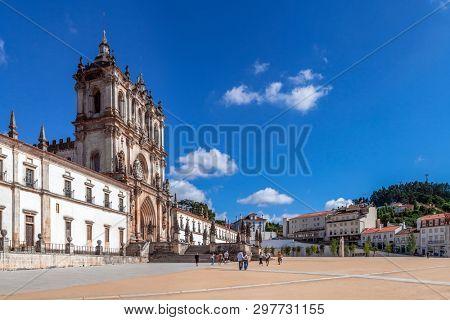 Alcobaca, Portugal - July 17, 2017: Exterior facade of Monastery of Santa Maria de Alcobaca Abbey. Masterpiece of Medieval Gothic architecture. Cistercian Religious Order