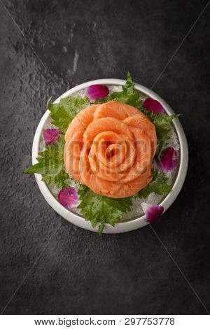 Rose Shape Salmon Sashimi In A White Ceramic Dish