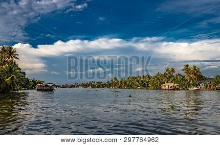 Backwater View At Alleppey Kerala India With Blue Sky And Palm Tree