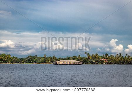 Houseboat Image From Distance With Wide View Of Blue Sky And Cloud At Alleppey Kerala India.