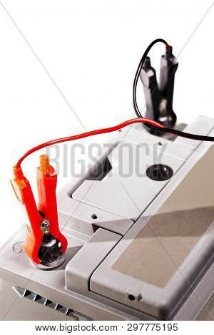 Charging The Car Battery With Jumper Cables. Close-up Photo, Copy Space