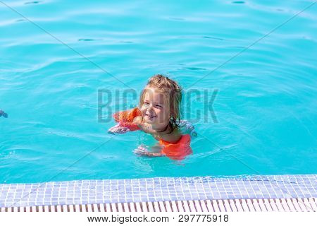 Happy Child Girl In A Swimming Pool