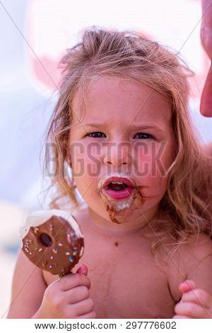 Happy Cute Toddler Girl Eating Ice - Cream
