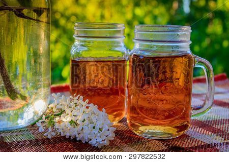 Cold Drink Tea Black In Glasses. Tea On The Balcony. Tea For Two. Cold Drink. Bouquet Of Flowers . F