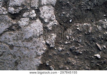 Stone And Soil Texture Background With Dust And Granular Particles. Close Up Macro Of Rustic Terrain