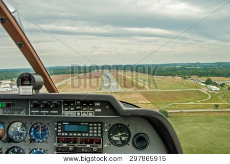A View From The Cockpit Of A Sports Aircraft To The Runway Of An Airfield