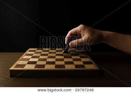 Man holding chess piece