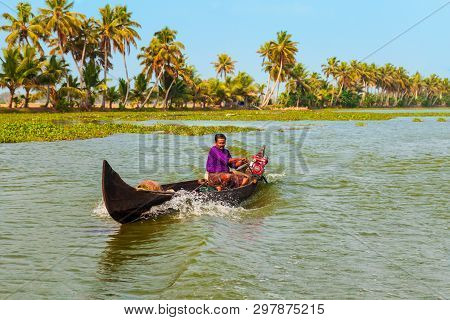 Alappuzha, India - March 18, 2012: Unidentified Man Sailing Boat In Alappuzha Backwaters In Kerala S