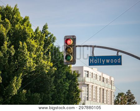 Hollywood Blvd Street Sign On Traffic Light At Intersection In Los Angeles