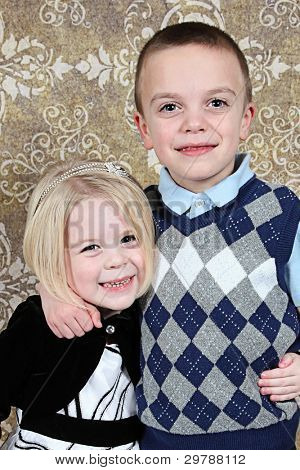 Adorable little brother and Sister on studio background