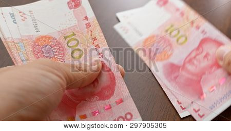 Counting Chinese RMB banknote close up