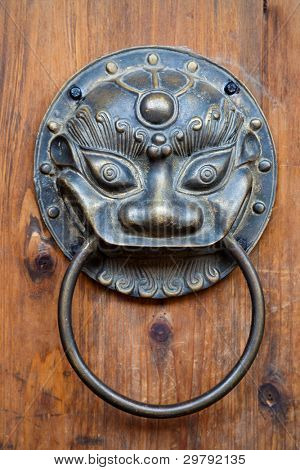 Chinese unicorn door knob on wood.Chinese unicorn, also name kylin,is an auspicious symbol in china