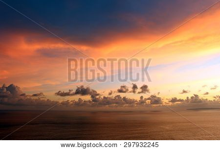poster of Beautiful sky colors and the ocean view background. Sky at magic hours background. Colorful sky background. Copy space for text or design background. Sunset nature landscape background. Sky pattern colors. Dramatic sky. Sunset sky.