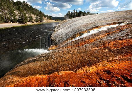 Stream Flows From Steaming Hot Spring In The Yellowstone National Park, Usa