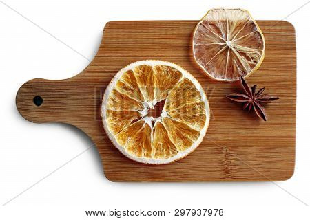 Still Life With Dried Slices Of Orange, Lemon And Star Anise Seed On The Wooden Cutting Board Agains