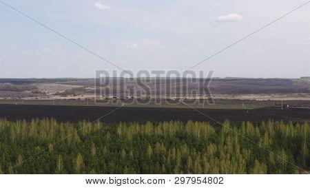 Aerial Survey Of Arable Land. Plowed Field. Fertile Land Of Arable Land. Sowing. Fly Over The Arable