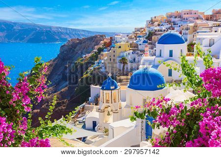 Santorini Island, Greece. Oia Town Traditional White Houses And Churches With Blue Domes Over The Ca