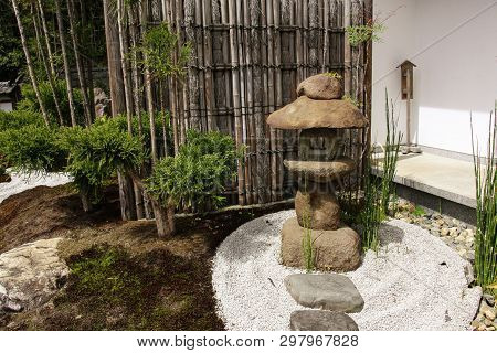 Stone Lantern And Bamboo Partition In Traditional Japanese Zen Garden In Hasedera Or Hase-kannon Shi