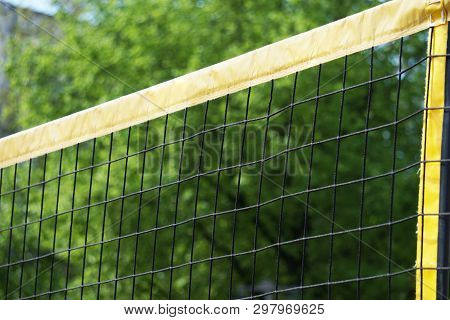 Beach Volleball Net Against Trees - Sports Background With Copy Space