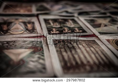 Closeup Of Occult Mystic Tarot Deck And Old Tarot Cards Laying On Table For A Magical Pagan Psychic