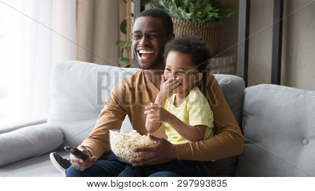 African Father Holding On Lap Little Son Family Watching Movie