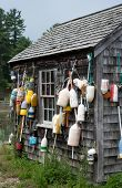 Lobster buoys and fishing shack on John Hancock Wharf - York Harbor Maine poster