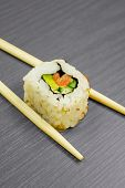 Japanese sushi and sticks isolated on black wooden board poster