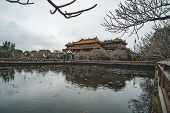 Scenic side view of the Meridian Gate and a moat surrounding the Imperial City with the Purple Forbidden City within the Citadel in Hue, Vietnam. Hue is a popular tourist destination of Asia poster