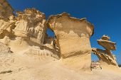 Desertic landscape of Erosion rocks, natural formations in Bolnuevo, Murcia, Spain. poster