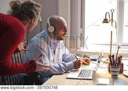wife disturbs her husband screaming while working at home