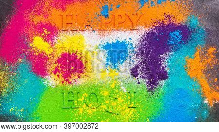 Holi Background With Colored Powder. Holi Festival, Traditional Indian Holiday. Happy Holi Lettering