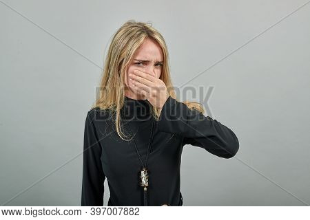 Covering Nose With Hand Showing Something Stinks, Isolated, Hands Face Against, Staring Into Camera,
