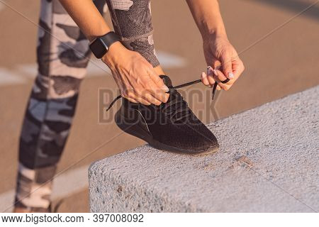 Close Up Of Sporty Caucasian Woman Runner Tying Shoelaces. Preparing For A Run. Fitness, Wellness, H