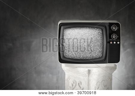 Old portable television with static noise.