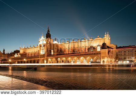 Krakow Attractions In Market Square In The Evening. Symbol Of Krakow, Poland Europe.