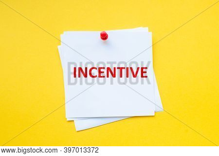 Incentive. Word On White Sticker With Yellow Background