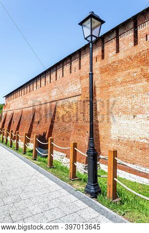 Red Brick Wall Of Medieval Kolomna Kremlin. Russian History, Sightseeing And Ancient Architecture