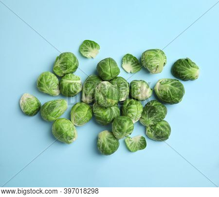 Fresh Brussels Sprouts On Light Blue Background, Flat Lay