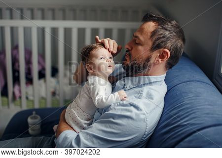 Fathers Day. Caucasian Father Talking To Newborn Baby Girl. Parent Holding Rocking Child Daughter In