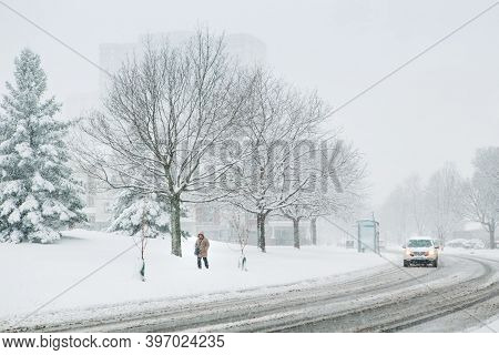 Man Walking Under Snow. Heavy Snowfall And Snowstorm In Toronto, Ontario, Canada. Snow Blizzard And