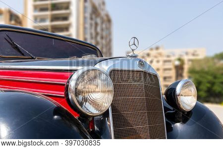 Cairo, Egypt- July 29 2020: 1953 Black And Red Mercedes Antique Car, Displayed In Front Of Baron Emp
