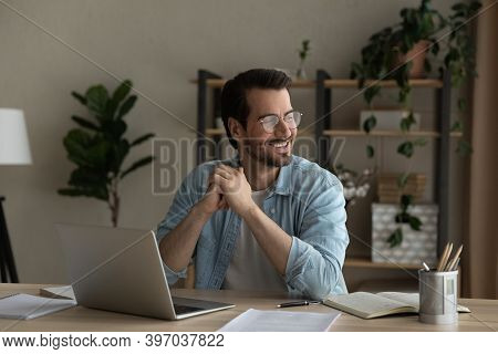 Smiling Young Man Dream Distracted From Computer Work