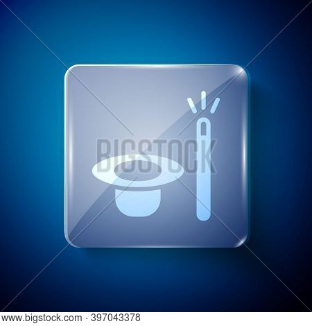 White Magic Hat And Wand Icon Isolated On Blue Background. Magic Trick. Mystery Entertainment Concep