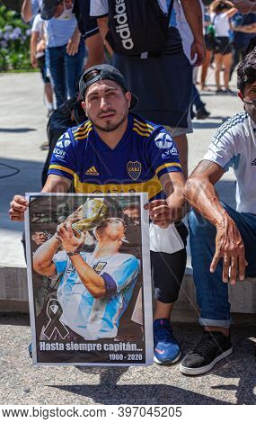 Buenos Aires, Argentina - 26 November, 2020:  Photos, drawings, posters with a portrait of Diego Maradona in the hands of fans on the day of farewell to the idol