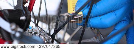 Hands Measure With Tape Measure In Bicycle Wheel. Man Is Repairing Bicycle Wheel. Mechanical Part Bi