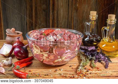 Boneless Lamb Steak, Sliced And Marinated With Onions, Meat In A Glass Bowl, Basil, Chili Pepper, Ma