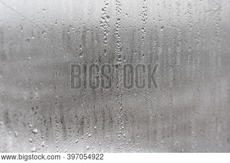 Natural Drops Of Water Flow Down The Glass, High Humidity In The Room, Condensation On The Glass Win