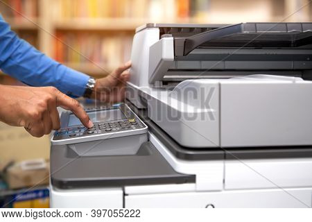 Close Up Hand Of Office Man Is Press The Button On Panel Of The Copier In Copy Room To For Scanning